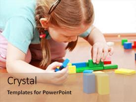 <b>Crystal</b> PowerPoint template with adorable girl playing with blocks themed background and a coral colored foreground design featuring a [design description].