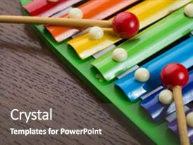 <b>Crystal</b> PowerPoint template with toy xylophone children s music themed background and a dark gray colored foreground design featuring a [design description].