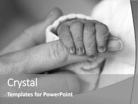 <b>Crystal</b> PowerPoint template with up of newborn baby hand themed background and a gray colored foreground design featuring a [design description].